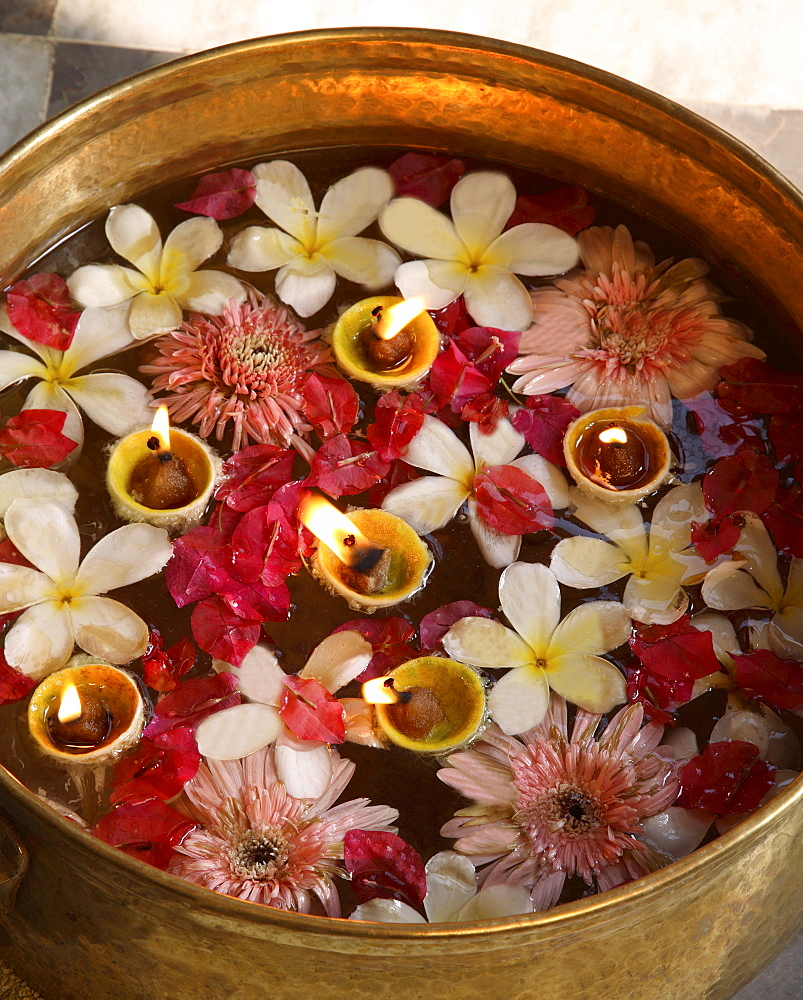 Flower pot with candles in an Indian Spa, India, Asia