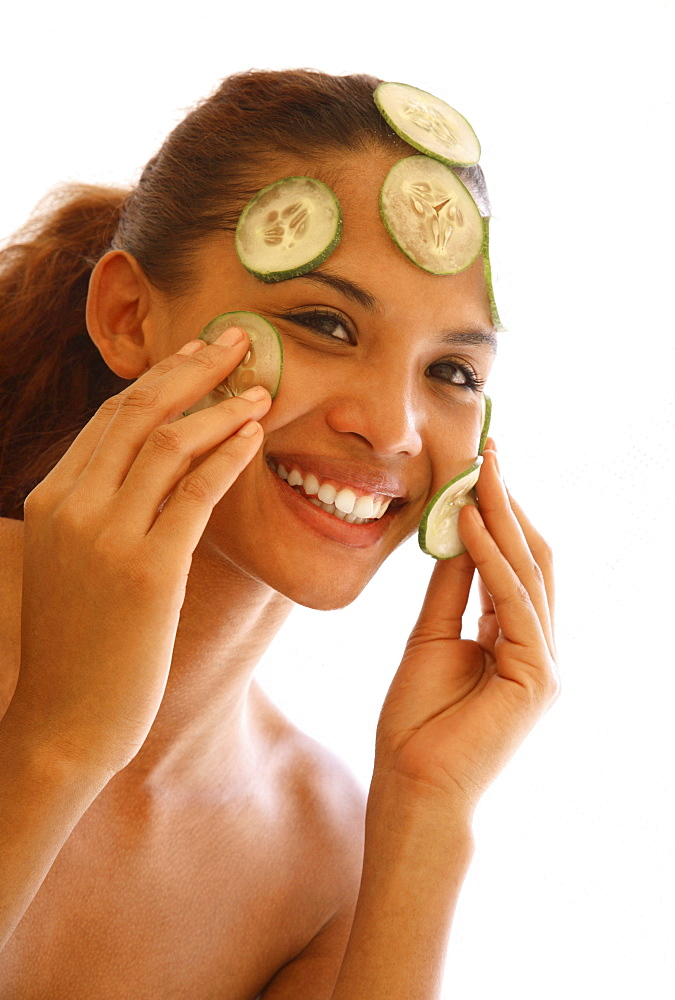 Young woman with cucumber facial