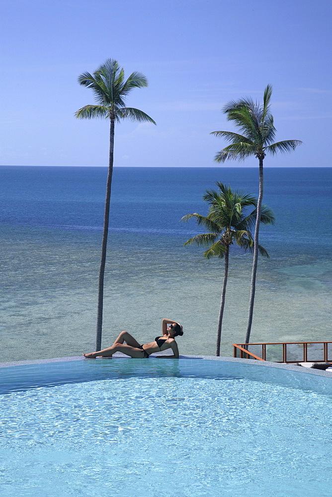 Girl at the pool at Sasha Resort in Koh Samui, Thailand, Southeast Asia, Asia