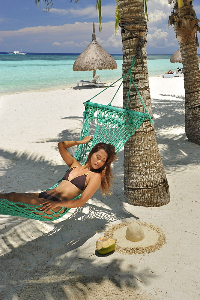 Girl on a hammock, Bohol Beach, Philippines, Southeast Asia, Asia