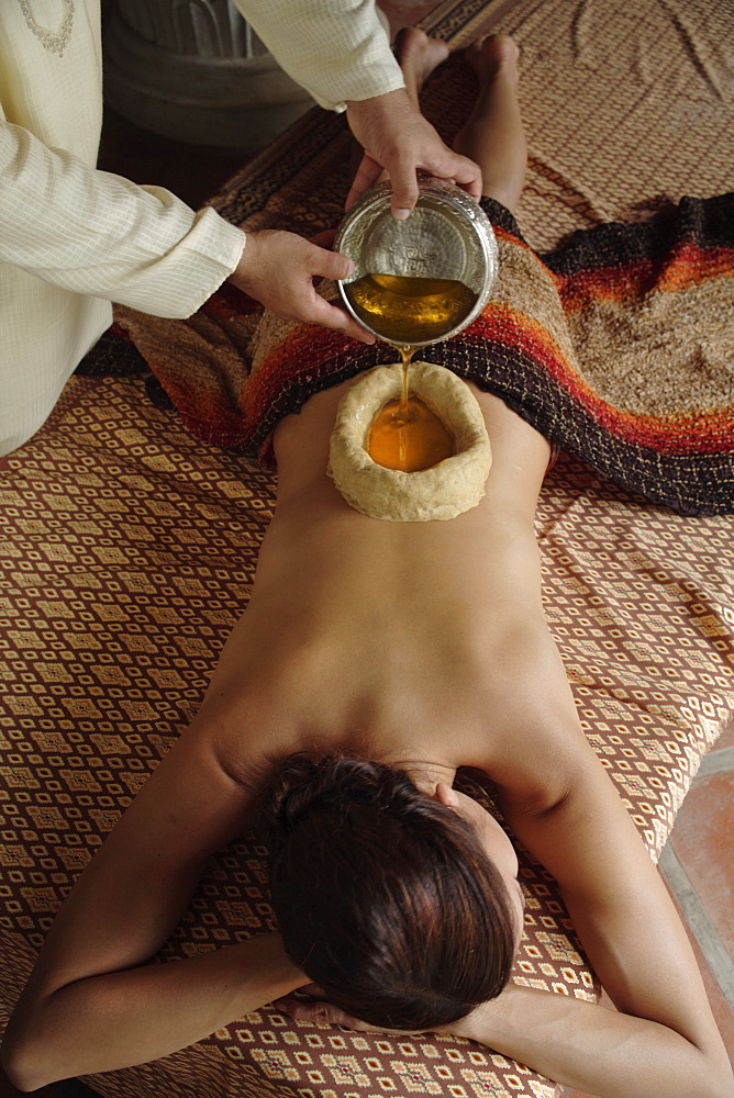 Kathibasti (kathivasti), the administration of hot medicated oils on to the body, contained in an enclosure made of dough, India, Asia
