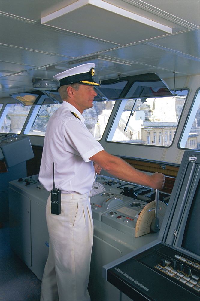 Ship's captain on the bridge, cruise ship