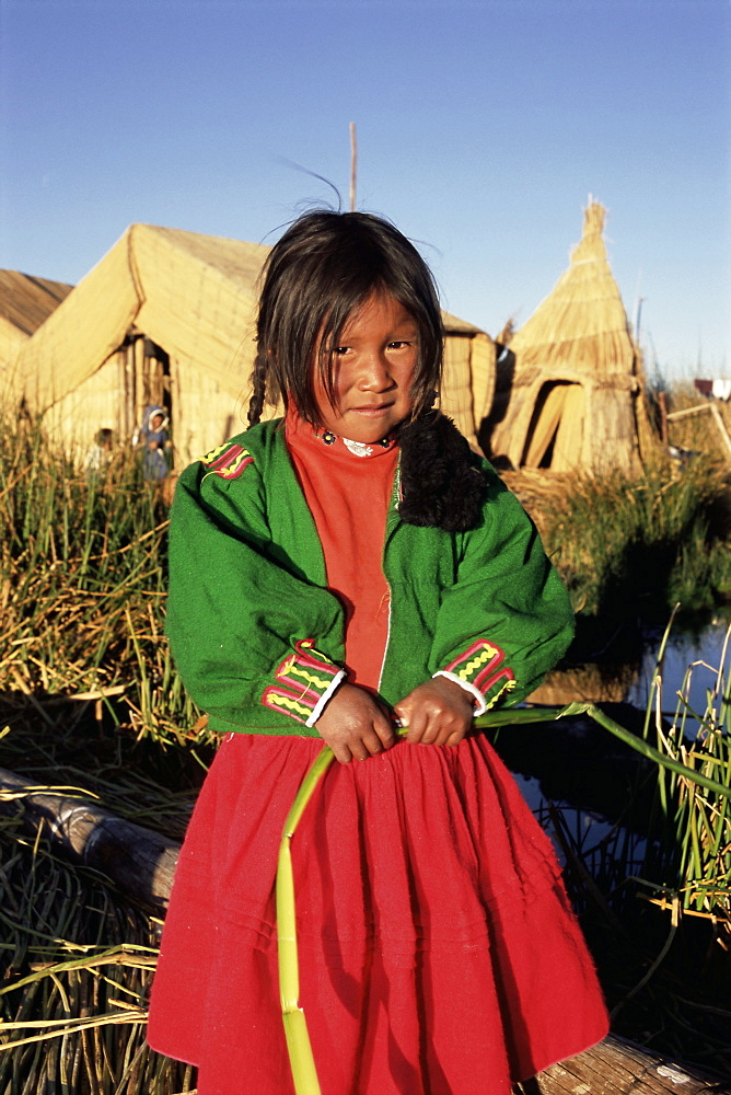 Portrait of a Uros Indian girl on a floading reed island, Islas Flotantes, Lake Titicaca, Peru, South America