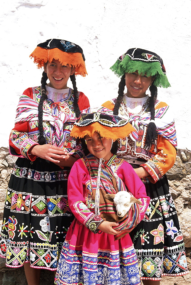 Portrait of three local Peruvian girls in traditional dress, looking at the camera, Cuzco (Cusco), Peru, South America