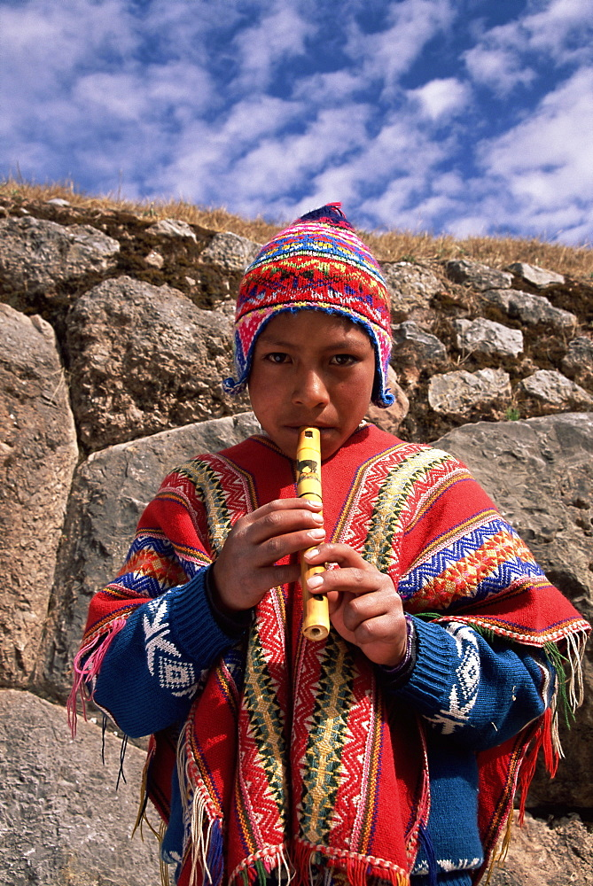 Peruvian boy playing the flute, Peru, South America - 252-10482