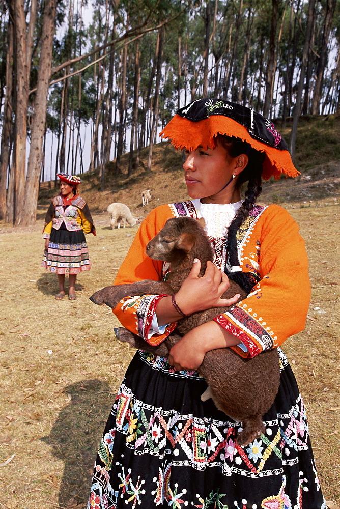 Portrait of a local Peruvian young woman in traditional dress, Cuzco (Cusco), Peru, South America