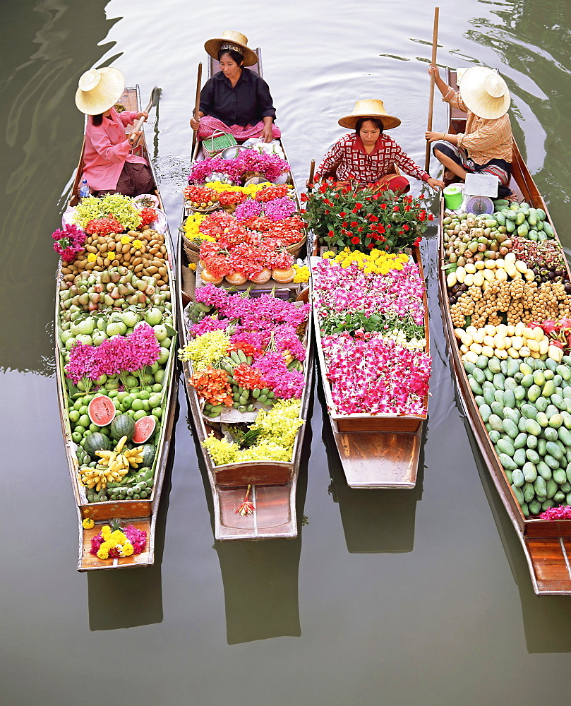 A group of four women market traders in boats laden with fruit and flowers, Damnoen Saduak floating market, Bangkok, Thailand, Southeast Asia, Asia - 252-10601
