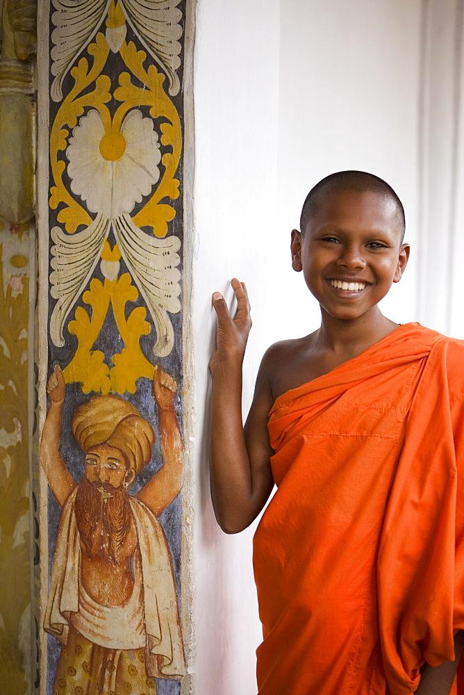 Portrait of a novice Buddhist monk, Kandy, Sri Lanka, Asia