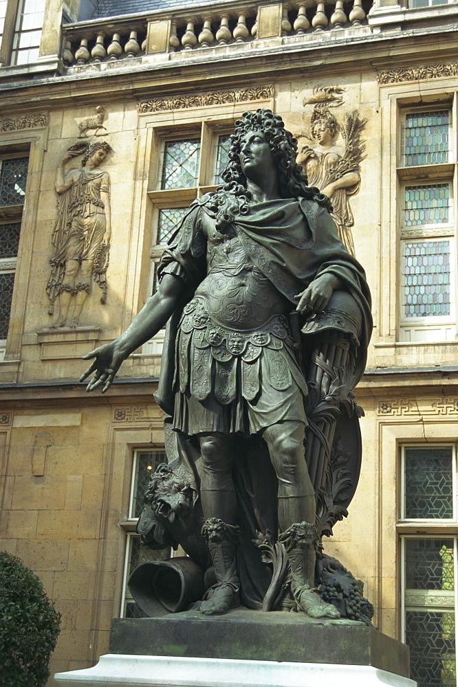 Statue of Louis XIV outside the Renaissance building of the Hotel Carnavalet, Le Marais, Paris, France, Europe - 253-2451