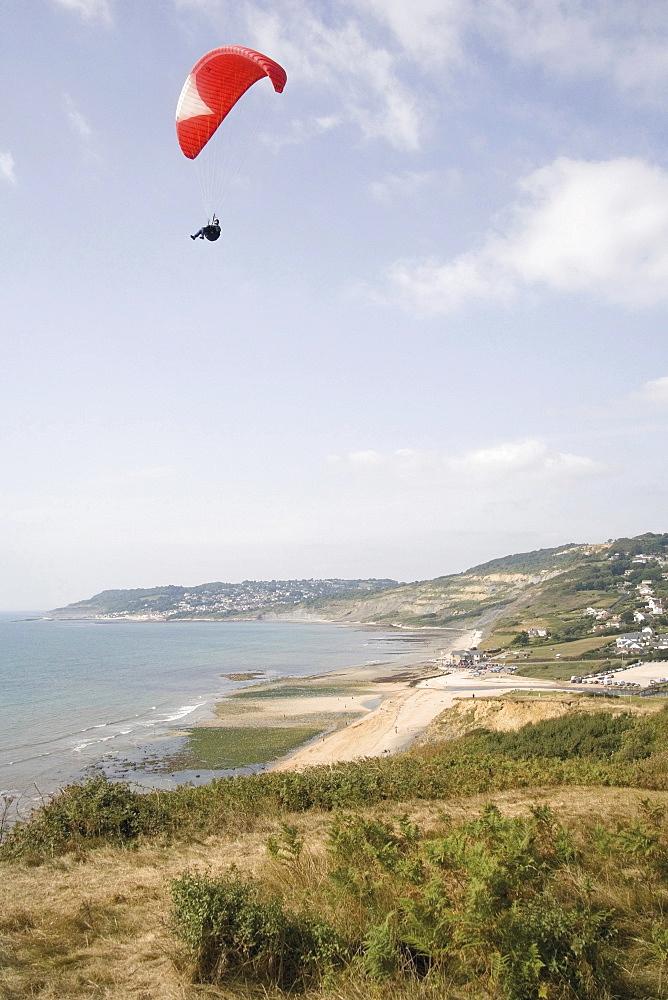 Hang glider over the Jurassic Coast, UNESCO World Heritage Site, Charmouth, Dorset, England, United Kingdom, Europe