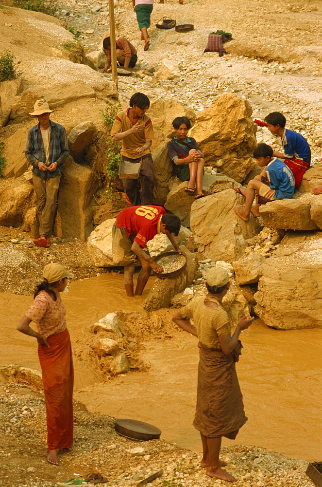 Children sieving and washing small gems from stream below mine, Mogok ruby mines, near Mandalay, Myanmar (Burma), Asia