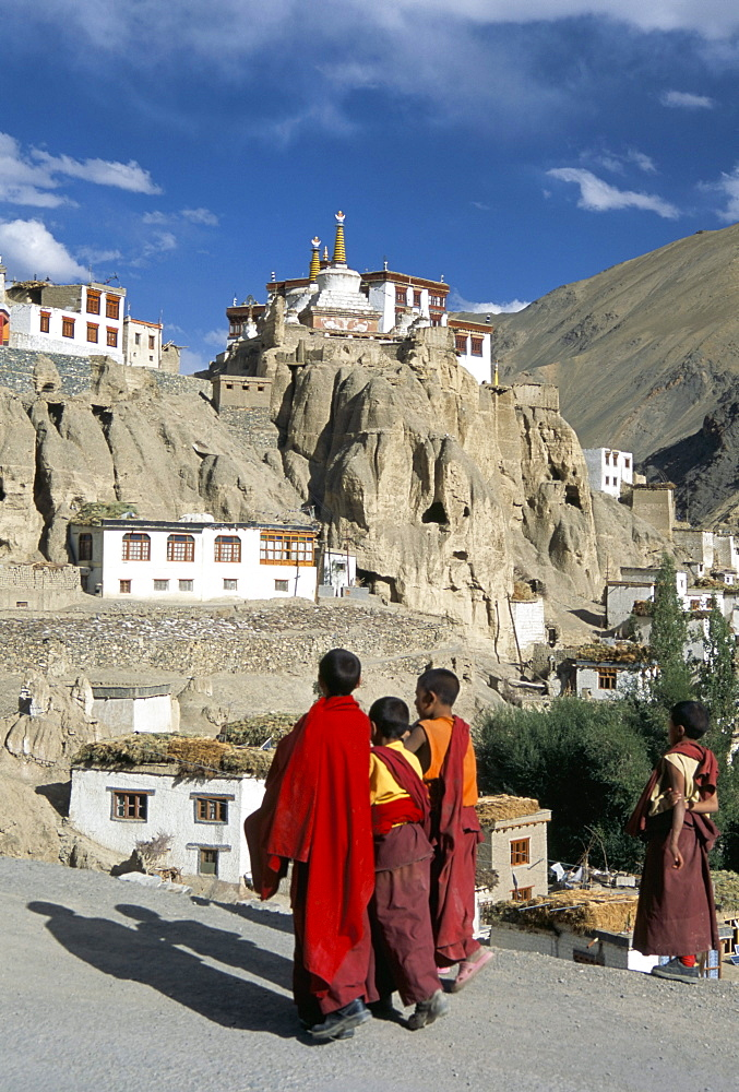 Novice monks walk from village, Lamayuru monastery, Ladakh, India, Asia