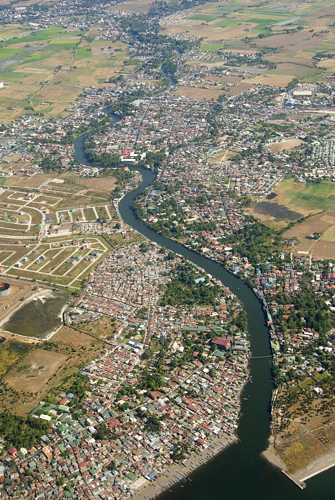 Aerial view of dormitory township on river into south end of Manila Bay, Manila, Philippines, Southeast Asia, Asia