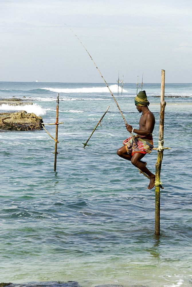 Traditional stilt fisherman, Koggala, near Weligama, south coast of Sri Lanka, Asia