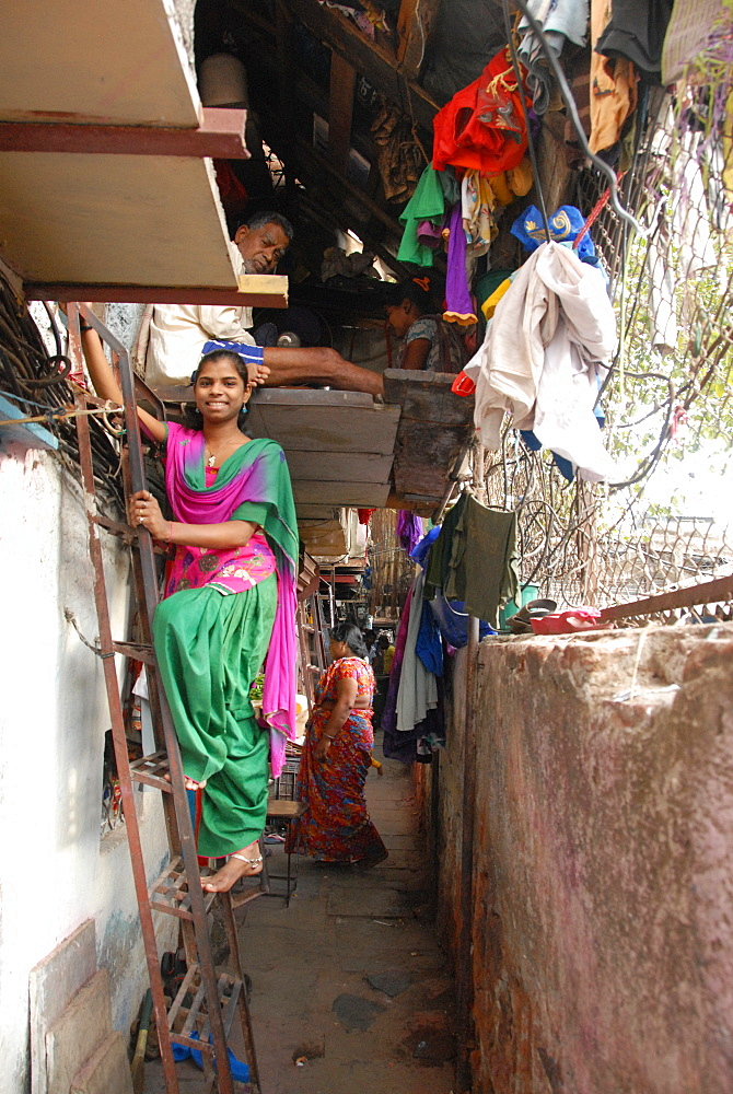 Narrow street and 2-layer houses, Colaba fishing village, southern end of Mumbai city, Maharashtra, India, Asia