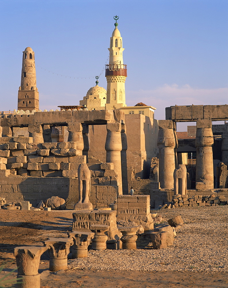 Ruins of the Luxor Temple, and the minaret of the Abu el Haggag Mosque built in the middle, Luxor, Thebes, UNESCO World Heritage Site, Egypt, North Africa, Africa