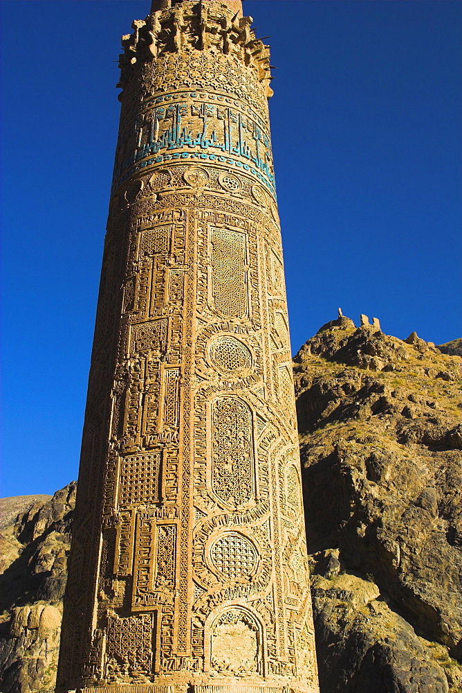 Detail of the 12th century Minaret of Jam, including Kufic inscription in turquoise glazed tiles, Quasr Zarafshan in background, UNESCO World Heritage Site, Ghor (Ghur, Ghowr) Province, Afghanistan, Asia