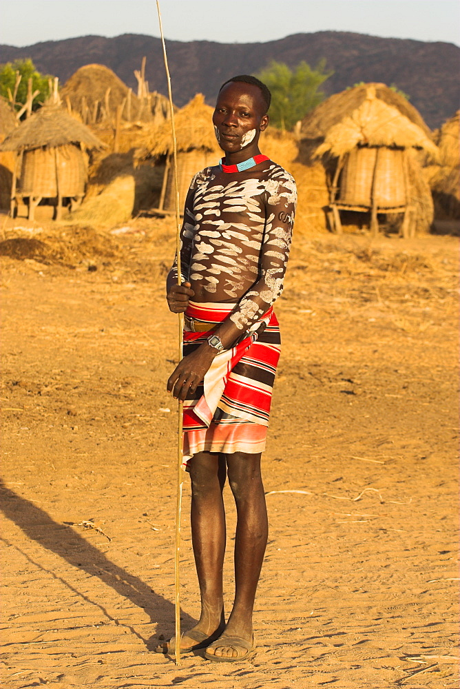 Karo man with body painting, made from mixing animal pigments with clay, at dancing performance, Kolcho village, Lower Omo valley, Ethiopia, Africa