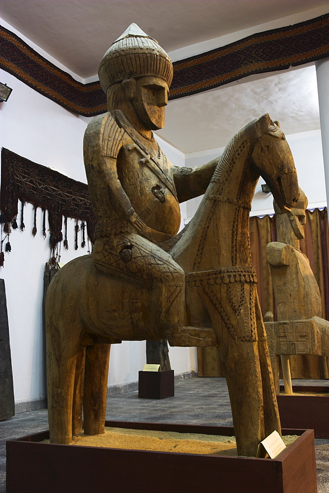Famous Nuristan wooden statue of king on horse, Kabul Museum, Kabul, Afghanistan, Asia