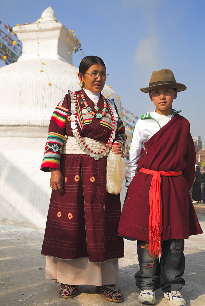 Tibetan mother and son in traditional clothes at Lhosar (Tibetan and Sherpa New Year) festival, Bodhnath stupa, UNESCO World Heritage Site, Bagmati, Kathmandu, Nepal, Asia
