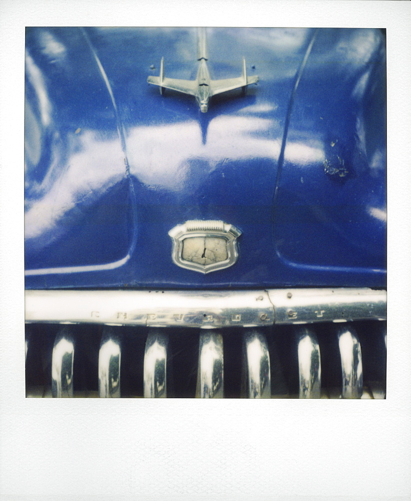 Polaroid of detail of bonnet and chrome grill of blue classic American car, Havana, Cuba, West Indies, Central America