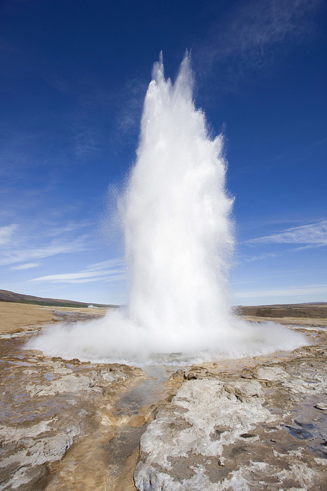 Plume of water and steam from the Strokkur Geysir exploding into the air at Geysir near Reykjavik, Iceland, Polar Regions