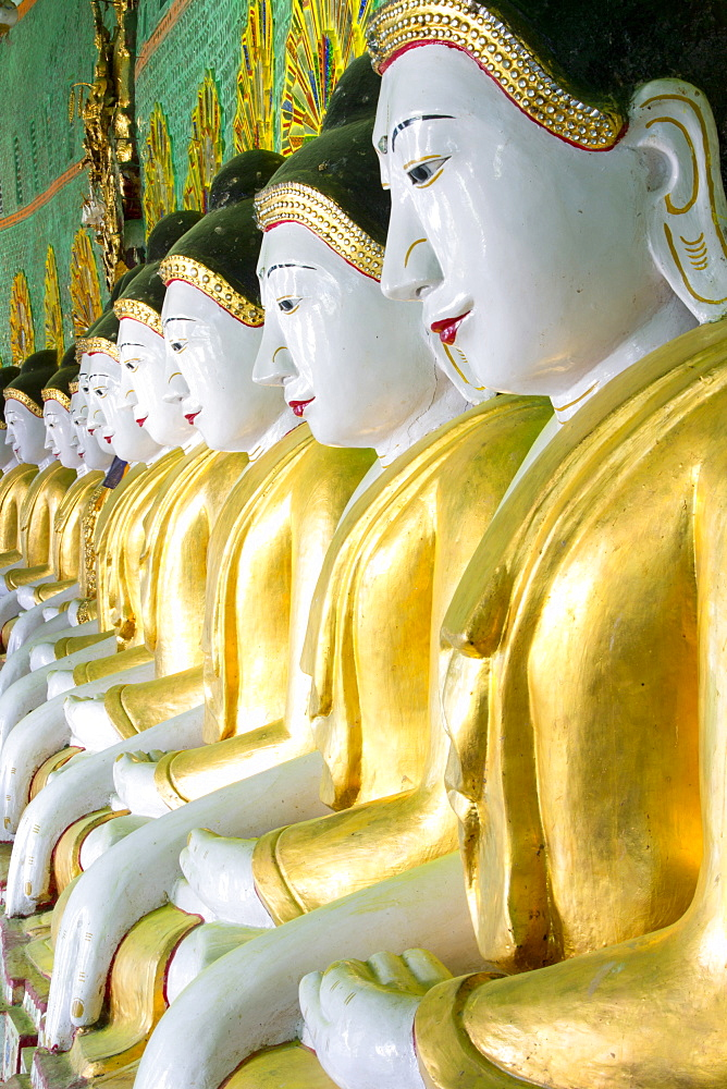Some of the 45 Buddha images found at a crescent-shaped colonnade at Umin Thounzeh on Sagaing Hill, near Mandalay, Myanmar (Burma), Asia  - 321-5088
