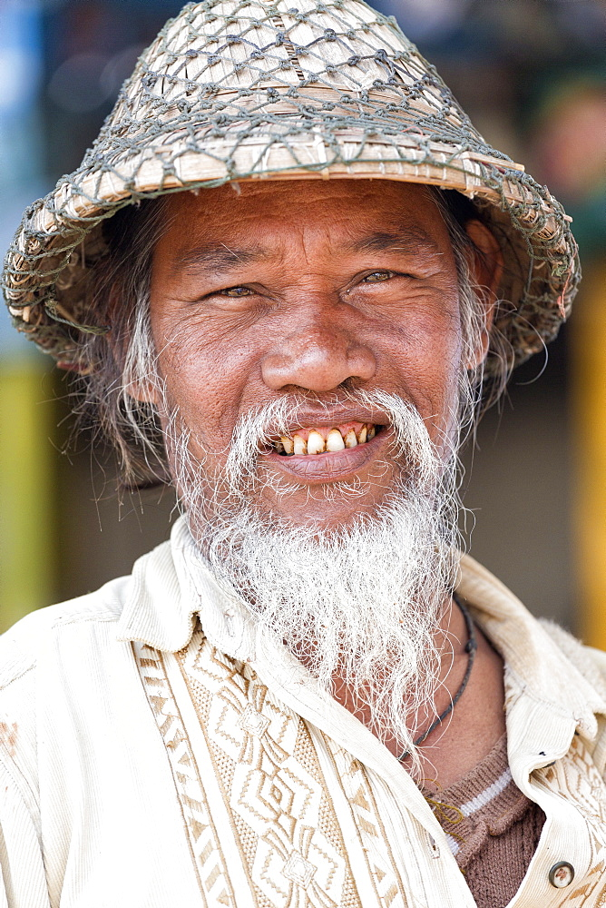 Local man wearing traditional bamboo hat, Amarapura, near Mandalay, Myanmar (Burma), Asia