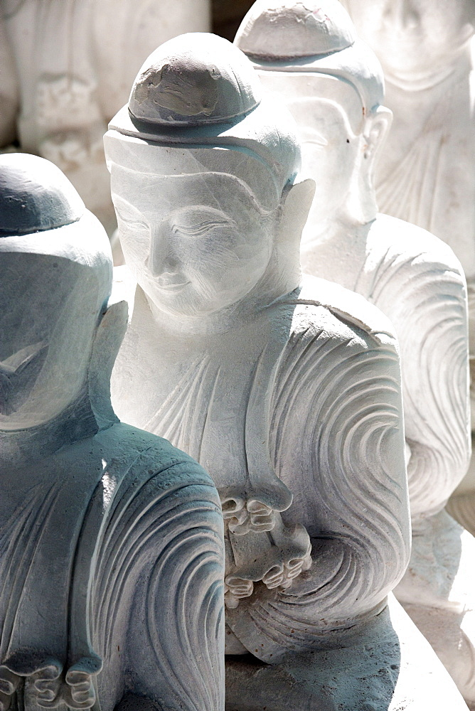 Marble Buddha images waiting to be finished at a stone carver's in Amarapura, near Mandalay, Myanmar (Burma), Southeast Asia