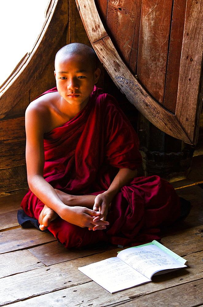 Novice Buddhist monk in lesson at Shwe Yaunghwe Kyaung, a famous teak monastery, Nyaungshwe, Inle Lake, Shan State, Myanmar (Burma),Asia