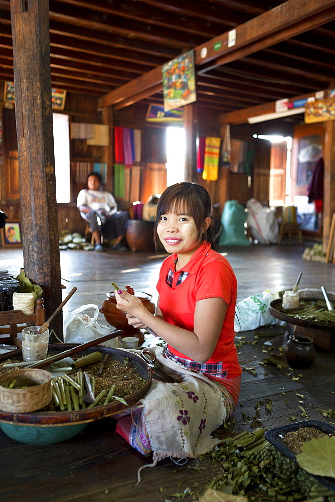 Young woman making cheroots in local factory, Nampan village, Inle lake, Myanmar (Burma), Southeast Asia
