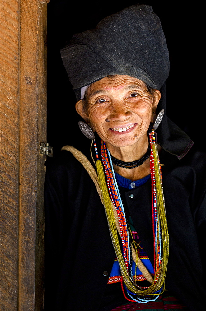 Woman of the Ann tribe in traditional black dress and colourful beads in a hill village near Kengtung (Kyaingtong), Shan State, Myanmar (Burma), Asia