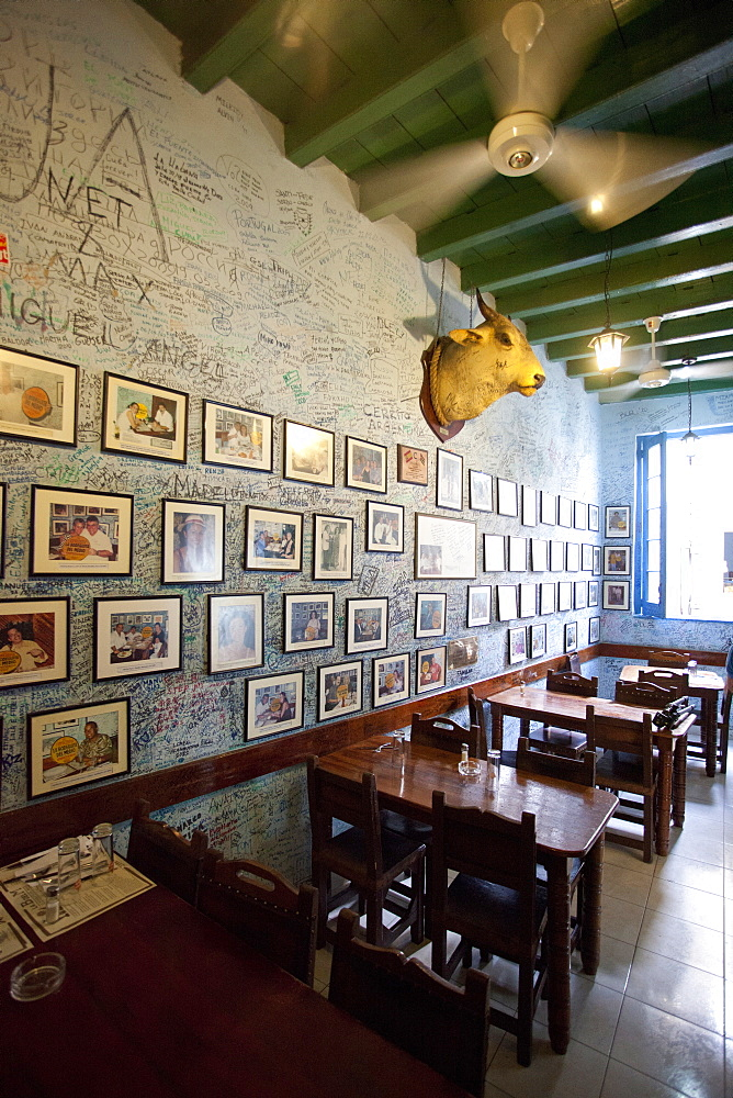 Interior of Bogadito del Medio, walls covered in graffiti, one of late author Ernest Hemingway's favourite bars, Havana Viejo, Havana, Cuba, West Indies, Central America
