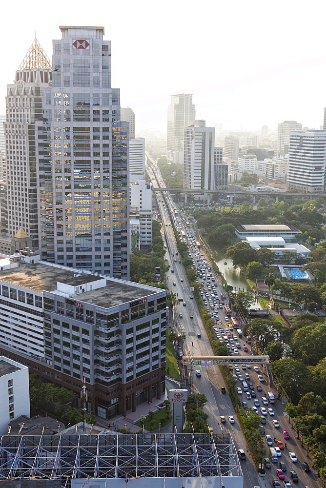 View of high rise buildings and traffic congestion on Rama IV in hazy evening light, from the roof of Hotel Sofitel So, Sathorn Road, Bangkok, Thailand, Southeast Asia, Asia