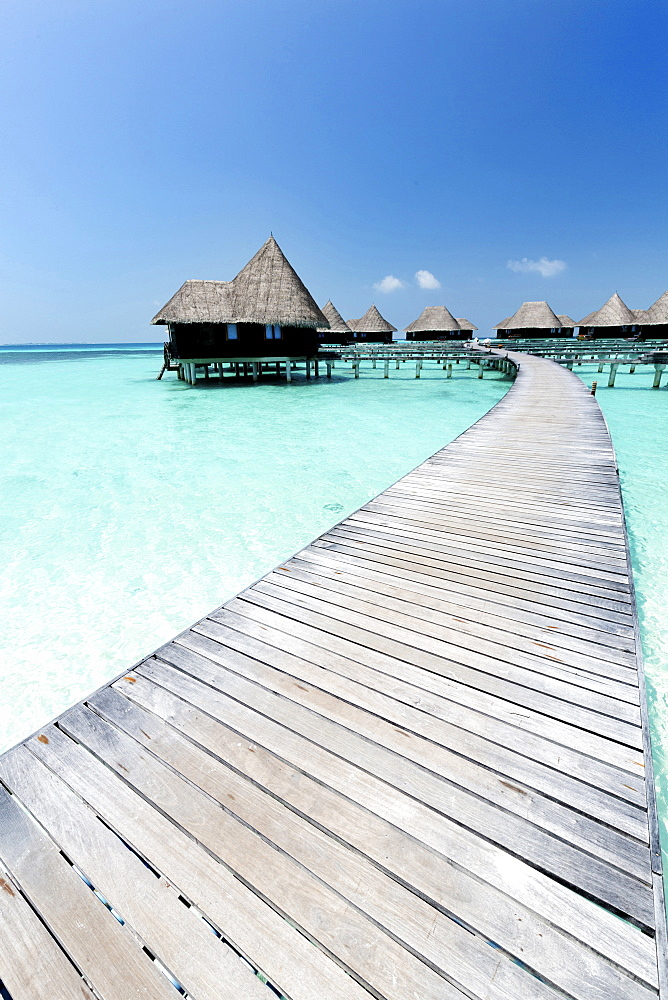 Over-water villas, crystal clear sea and blue sky, Coco Palm, Dhuni Kolhu, Baa Atoll, Republic of Maldives, Indian Ocean, Asia