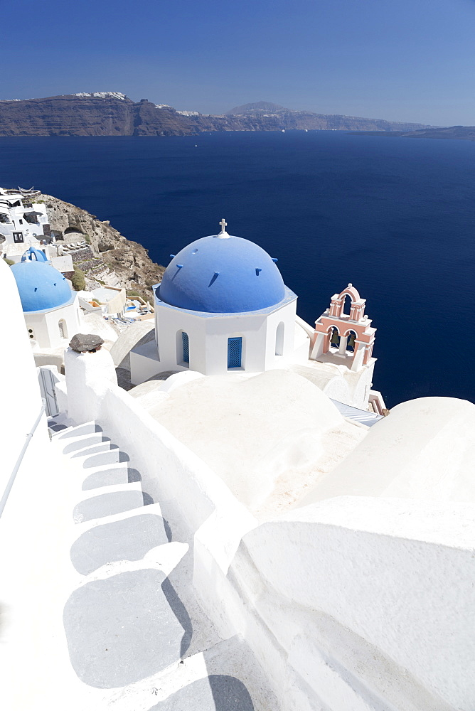 Steps leading to white church with blue dome overlooking the Caldera, Oia, Santorini, Cyclades, Greek Islands, Greece, Europe