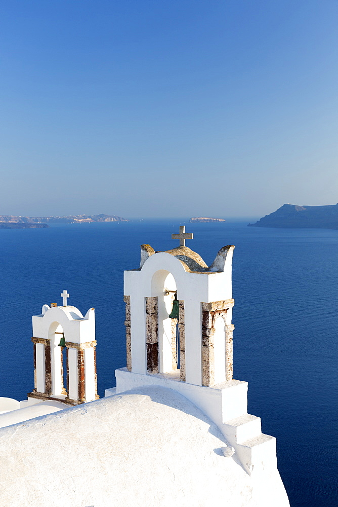 White church belltowers overlooking the Caldera, Oia, Santorini, Cyclades, Greek Islands, Greece, Europe