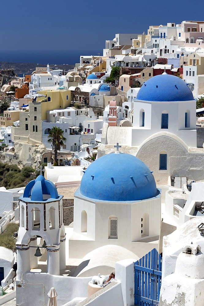Classic view of the village of Oia with its blue domed churches and colourful houses, Oia, Santorini, Cyclades, Greek Islands, Greece, Europe