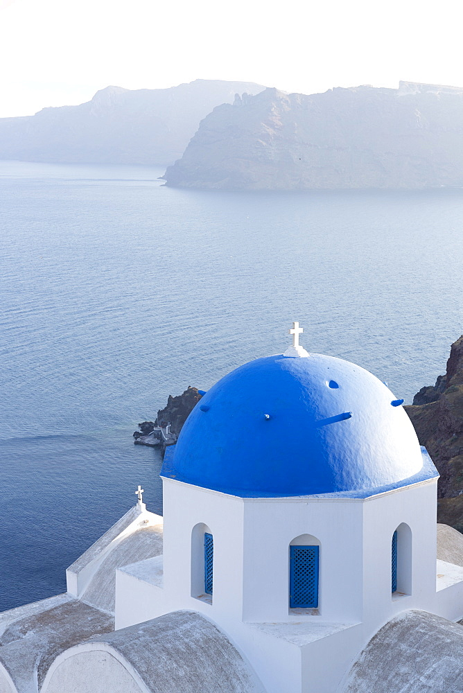 White church with blue dome overlooking the Caldera, Oia, Santorini, Cyclades Islands, Greek Islands, Greece, Europe