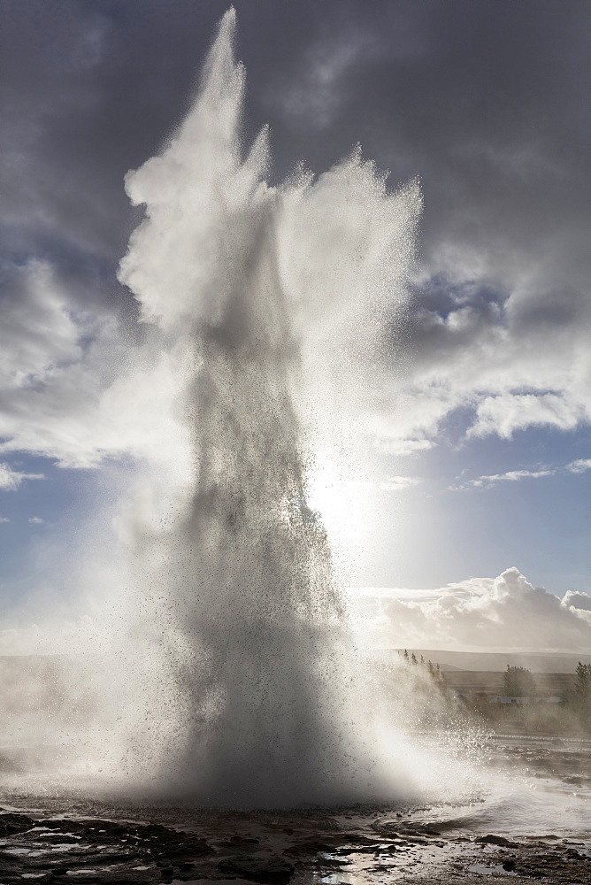 Strokkur Geysir erupting against stormy sky, Geysir, South West Iceland, Polar Regions