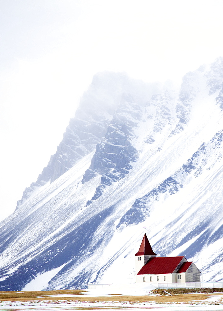 Church against snow covered mountains, winter afternoon, Snaefellsnes Peninsula, Iceland, Polar Regions