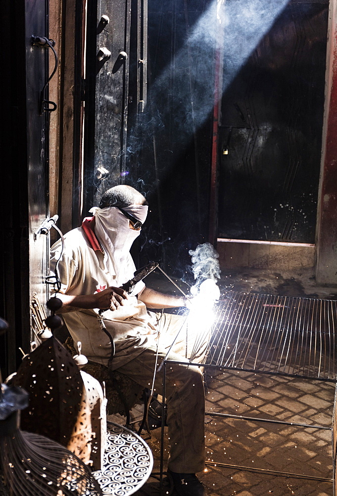 Worker in Blacksmiths Souk welding metal, Marrakech, Morocco, North Africa, Africa
