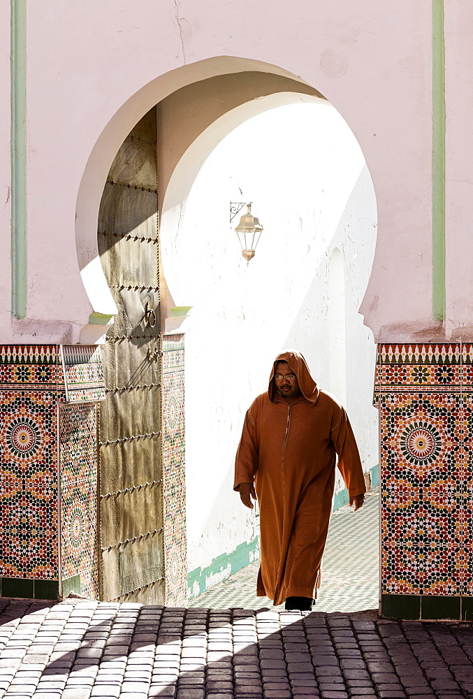 Local man dressed in traditional djellaba walking out of mosque in the Kasbah, Marrakech, Morocco, North Africa, Africa - 321-5850