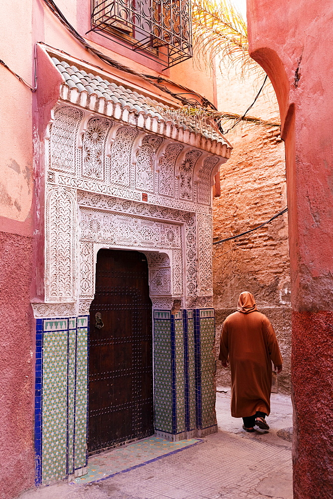 Local man dressed in traditional djellaba walking through street in the Kasbah, Marrakech, Morocco, North Africa, Africa - 321-5851