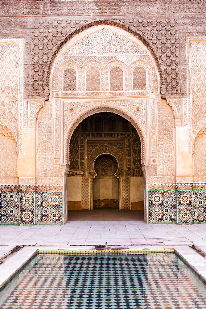 Wall of Ben Youssef Madrasa (ancient Islamic college) with reflection in pool of water, UNESCO World Heritage Site, Marrakech, Morocco, North Africa, Africa - 321-5856