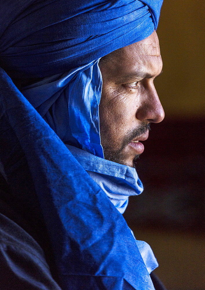 Portrait of Berber man wearing traditional blue robes, village of Hassi Labiad, near Merzouga, Morocco
