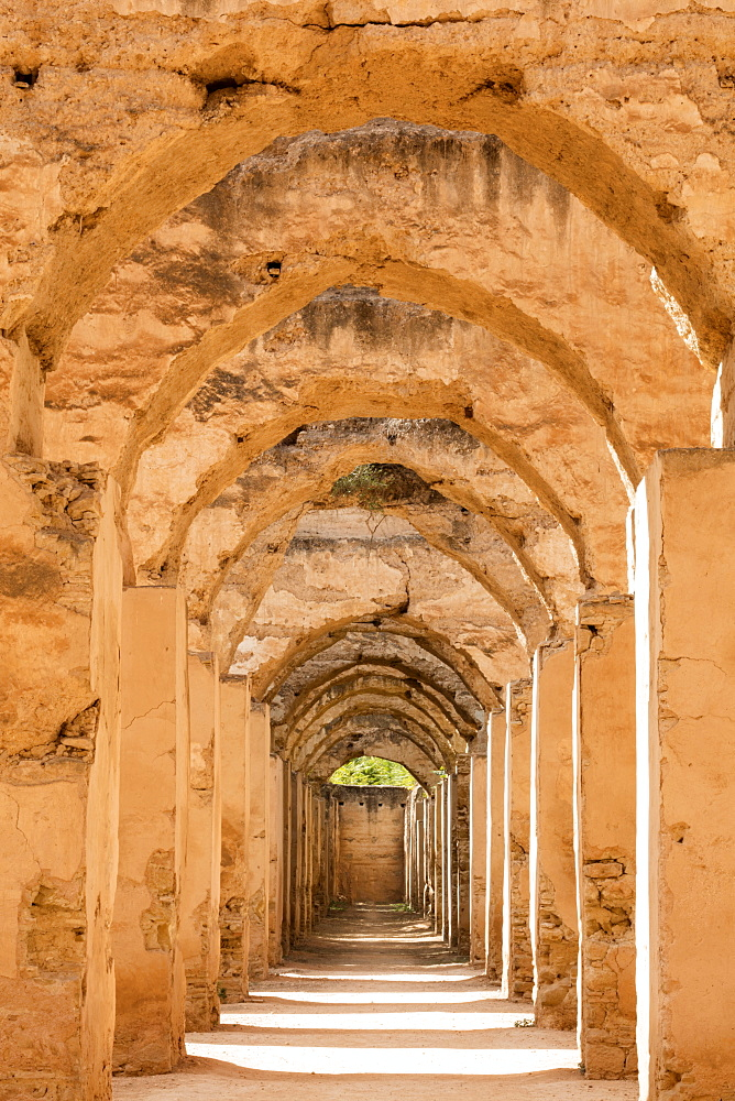 Arches inside Hri Souani, the Royal Stables of Moulay Ismail, Meknes, Morocco, North Africa, Africa