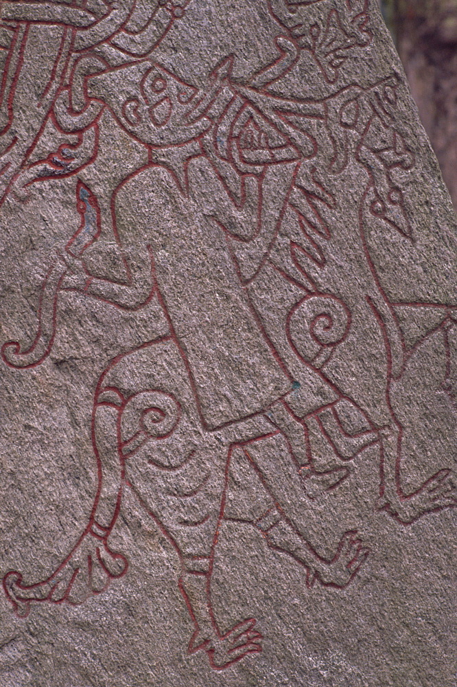 Witch from Icelandic Edda riding a wolf, detail of standing stone circa 1000AD, Lund, Sweden, Scandinavia, Europe - 341-1005