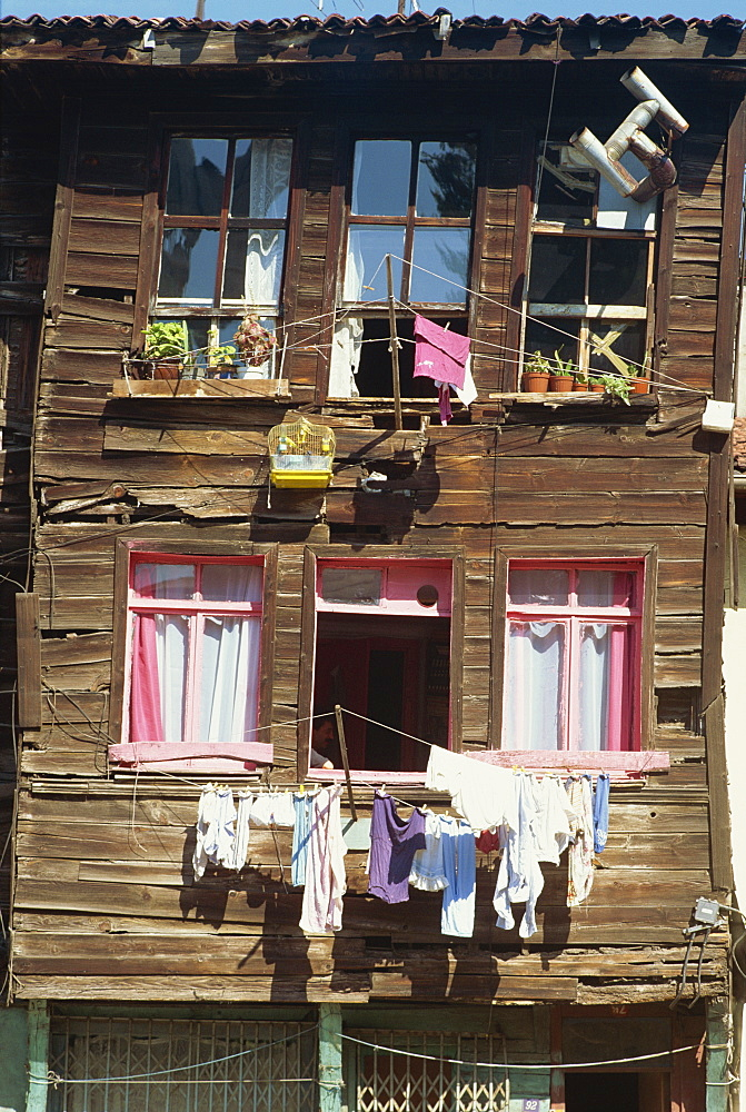 Bird cage and washing lines on the front of a traditional wooden house in the old city of Istanbul, Turkey, Europe