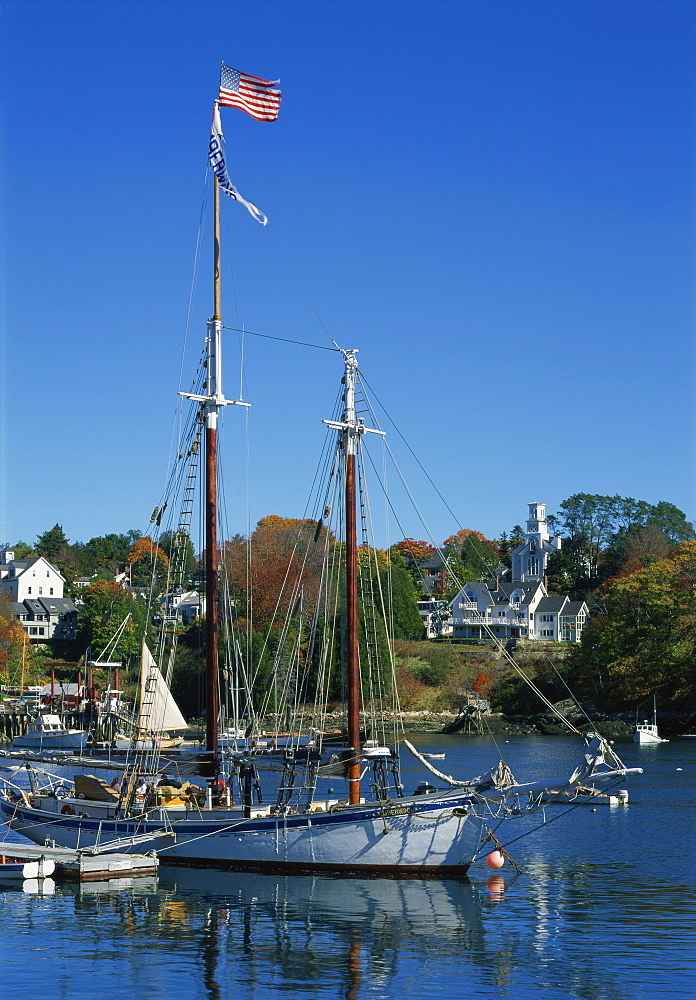 Traditional boat flying the Stars & Stripes, moored in the harbour at Rockport, Maine, New England, United States of America, North America